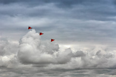 Three Kites (Hugh Rawson) Tags: clouds france sky stgermainsuray normandy kite red cloud