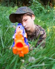 AubreyDayBefore9-7493.jpg (labrossephotography) Tags: boy son child 9yo grass camouflage nerfgun fun cap hat portrait availablelight naturallight sniper green eyecontact play bokeh dof shallowdepthoffield wideopen
