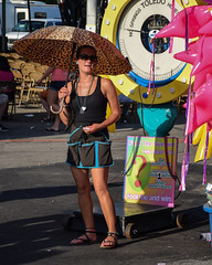 Guess Again (tim.perdue) Tags: ohio state fair 2016 summer exposition center columbus street candid colorful multicolored midway carnival fool guesser woman person figure umbrella scale