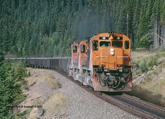.(SEE & HEAR) Cartier 48 74 77, mp22.5 QUE. 9-23-2000 (jackdk) Tags: railroad train cartier railway locomotive ore taconite alco mlw qcm oretrain c636 m636 mlw636 alcoc636 mlwm636 cartiermining