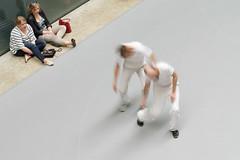 Tate Mod. 3 10jul16 (richardbw9) Tags: london uk england southwark tate tatemodern artgallery dance moderndance turbinehall blur longexposure spectators event annateresadekeersmaeker rosas pairs twopairs dancers whitetrousers city street urban interior londonstreetphotography handbag sunglasses