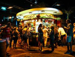 Fruit Stand (rlerner25) Tags: ben gurion tel aviv night photography people fruit stand juice color lights slow shutter israel crowd social side walk outdoor
