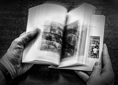 """Speed Reading.."" - Sample test shot (Ian Johnston LRPS) Tags: red test blur speed table 50mm reading book hands nikon shot pages fingers images read flick d800 2016"