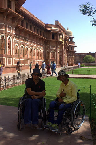 Accessible Tour to Agra:Two travellers on wheelchair posing for the camera.