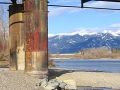 Rusted Pylons (Rock Water) Tags: swanrange mountains snowcappedmountains flatheadriver bridges pylons rust