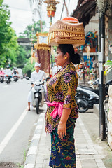 Woman carrying basket on the head (Evgeny Ermakov) Tags: asia asian bali balinese dayofsilence god indonesia indonesian newyear nyepi silence silenceday southeast southeastasia ubud ancient basket box candid carry carryonhead carrying carryingonhead celebration ceremony city clothes colorful colors cultural culture cultures decoration decorations destination exotic famous fashion gift girl head holiday holidays life local offering religion religious ritual scene scenery scenic spirituality street style touristic traditional travel typical vacation vibrant woman editorialuse