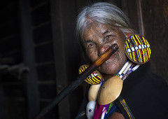 Yun Eian From Magan Tribe Playing Nose Flute, Mindat, Myanmar (Eric Lafforgue) Tags: travel people music woman art senior face horizontal tattoo female portraits asian photography design women asia day adult burma hill earring shell flute tribal headshot tattoos hills elderly tribes bead myanmar copyspace tribe tatoo ethnic minority aging burmese facial chin adultsonly oneperson customs hilltribe tattooing tattooed minorities senioradult traditionalclothing humanface traveldestinations darkbackground lookingatcamera magan tribalpeople 1people chinstate ethnicgroup facialdecoration facetattooed burma0767