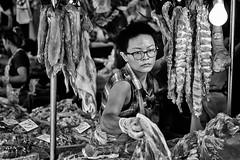 Khlong Toei Butcher (Greg Holtfreter) Tags: thailand market bangkok butcher fujifilm klong wetmarket toey xt1 khlongtoeimarket xf56mmf12