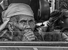 Elderly woman stares out her car window while in heavy traffic waiting to enter Shillong (stevebfotos) Tags: meghalaya shillong elderly bw woman topaz india in