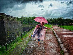 Pose at agauda fort. #iphone6s #travel #goa #rain #clouds #shotoniphone #fort #trees #pink #umbrella #raincoat #path Kritika Snehi (karan667) Tags: iphone6s travel goa rain clouds shotoniphone fort trees pink umbrella raincoat path