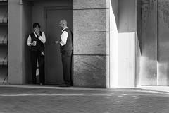 Cigarette Break (Torsten Reimer) Tags: streetphotography usa people smile candid northamerica unitedstatesofamerica woman boston smoking massachusetts schwarzweis blackandwhite man cigarette unitedstates us