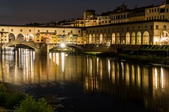 Night on the Arno (Anthony Plancherel) Tags: architecture category citiestowns corridoiovasariano external florence italy night nightscenes places pontevecchio time travel longexposure river water blur lightstars reflections nightscape cityscape firenze italian italia buildings bridge famousplaces arnoriver lights travelphotography architecturephotography tourism construction renaissance canon70d canon canon1585mm outdoor outdoors outside historic arches corridor cloister riverbank reeds span wow