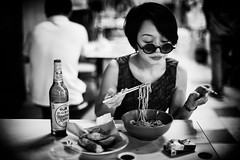 Last One Tonight (Jon Siegel) Tags: nikon nikkor d810 50mm 12 50mmf12 nikon50mmf12ais woman girl beautiful beauty smoking smoke cigarette beer noodles night evening eatery chinese chinatown singapore singaporean blackandwhite bw people cinematography cinematic