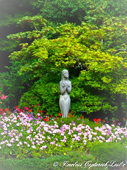 Garden Mother (Karl Outdoor Photography) Tags: flowers statue garden britishcolumbia praying mother victoria butchartgardens protecting