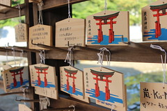 Scrawling Hope (Alison Claire~) Tags: wood macro japan canon temple eos rebel hope miyajima wishes wish offerings 600d
