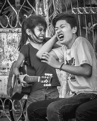 Never mess with your little sister (FotoGrazio) Tags: people ouch pain hurt guitar philippines streetphotography photojournalism streetscene siblings revenge scream angry argument littlegirl filipino mad fighting ilocos brotherandsister punishment painful pinoy laoag socialdocumentary disagreement pullinghair pacificislanders documentaryphotography siblingrivalry gettingeven batangbabae fotograzio waynegrazio
