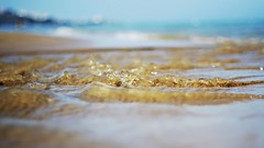 flow (SS) Tags: ss pentax k5 sand sea smcpentaxm50mmf17 summer shore seashore holiday beach vacation vieste gargano puglia italy outdoor people bokeh depthoffield waves water serene spiaggiadellascialara texture pattern gold blue