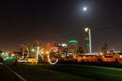 OKC (BenWestPhotography) Tags: city moon oklahoma skyline night canon raw 1750 dxo okc tamron oklahomacity lightwriting tamron1750f28 40d tamronspaf1750mmf28xrdiiildasphericalif canon40d devontower opticspro10