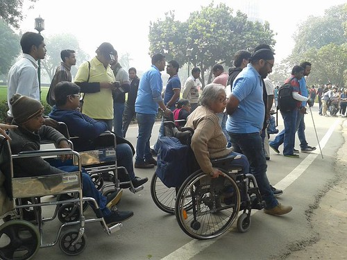Accessible Tour of Qutub Minar: Travellers with their travel buddies.