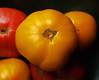 Tomato Still Life (Grazerin/Dorli B.) Tags: tomato heirloomtomato yellow red orange macro round shape elements blackbackground naturallight