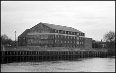 Gainsborough's Waterfront (tatrakoda) Tags: old uk england urban bw building history film monochrome 35mm river geotagged mono town blackwhite nikon riverside britain lincolnshire d76 trent epson hp5 analogue v600 f5 ilford grade2 listed gainsborough dn21 sandarsmaltings