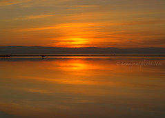 West Kirby Marine Lake Sunset (2009) (.annajane) Tags: uk sunset sea england sky orange lake reflection water marina coast marinelake wirral westkirby
