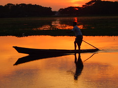 Boating with sunset. (Shafi Uddin1) Tags: light sunset sunlight lake man water river boat fishing nikon colorful fishermen ngc boating nikkor bangladesh nikoncoolpix nikonlens supershot manportrait beautifulbangladesh nikoncoolpixl830