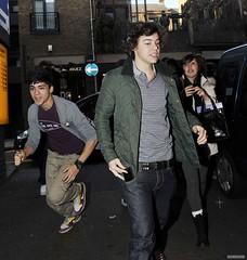 (One Direction Archive) Tags: uk funnyface london belt funny tshirt running fans runningaway greencoat xfactor funnyexpression greytshirt greenjacket onedirection zainmalik harrystyles zaynmalik gantjacket checkedtshirt