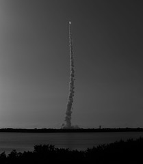 Atlas V Rocket Launch (Alex Szymanek) Tags: rocket launch atlas florida water dark sky skies space explore early fast trajectory takeoff ground elements spacecoast coast fly speed sound light soar elevation canon nasa 70200 markiii fl capecanaveral wet up moment away bw monochrome ignition exploration reach for stars roar summer 2016