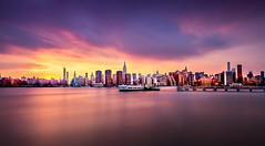 Manhattan skyline: sunset view from Brooklyn's Transmitter Park (ShanePix) Tags: newyorkcity newyork skyline manhattan longexposure sky clouds water ocean sea usa eastcoast boats boat financialdistrict oneworldtradecenter unitedstates nikon nikond4 daylight outdoor blur nd filter afternoon morning blue pink buildings skyscrapers skyscraper pier harbor color reflection architecture summer sunset dusk waterfront urban neutraldensity sunlight sun sunny sureal exposure city cityscape urbancityscape lowermanhattan hudson river shoreline coast longexposurephotography blending streaky light dark shadows abstract elitegalleryaoi bestcapturesaoi yellow transmitterpark brooklyn greenpoint williamsburg dock empirestate pinnaclephotography