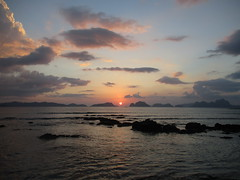Sunset over the Bacuit Archipelago from Las Cabanas Beach (omnia2070) Tags: philippines palawan el nido elnido las cabanas beach sunset water ocean sea orange red blue sky cloud limestone karst mountain rock rocky bacuit archipelago
