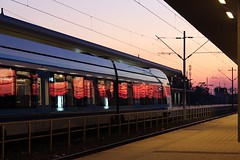 IMG_2255 (azaksek) Tags: train station railway sunset windows reflection city canon eos