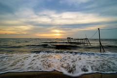 SURAM (mozakim) Tags: jeram kuala selangor waves ripple water sea beach muddy evening sunset sky clouds slowshutter