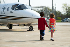 Darling, our private jet awaits. (DrSeaMonkey) Tags: boy cute love girl childhood kids plane private children holding hands friend couple child friendship sweet rich jet business 400 holdinghands beech hold beechjet 400a beechbusinessjet
