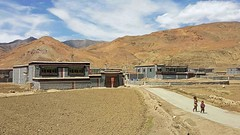 Village in Sakya Region 1 (joeng) Tags: tibet sakya landscape mountain sky clouds people places building
