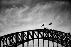 Our Flags, Our Bridge, Our People (sachman75) Tags: bridge blackandwhite bw architecture clouds australia nsw newsouthwales sydneyharbour sydneyharbourbridge australianicon canon70200mmf28is