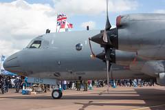 Flying the Flags (Al Henderson) Tags: england unitedkingdom aviation military gloucestershire airshow aurora gb lockheed raf 140105 fairford gander p3 mpa riat dunfield 407sqn airtattoo cp140 maritimepatrol canadianairforce blockiii cp140m