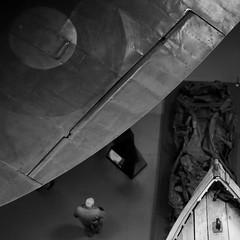 IWM2 - Spitfire (Andrew Malbon) Tags: london leica leicam9 m9 summilux 35mmf14 35mm f14 wideangle blackwhite bw monochrome mono spitfire raf roundel boat man bald wing wreck imperialwarmuseum museum rivets rangefinder handheld highiso maximumiso