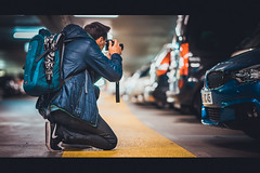 The Shooter (Bokehschtig (OFF)) Tags: bokeh street photographer aiming shooting sony a7 sonya7 sonyalpha movie bmw garage people person sel85f14gm 85mm f14 indoor mnchen munich