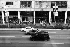 Downtown Race (Jeff Chia) Tags: blackandwhite cars monochrome race singapore cityscape somerset orchard sg bnw chasing iphone orchardroad phonephotography motorvehicle iphonography singaporeroad iphone6 somerset313