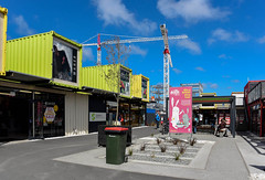 The Easter Bunny is About (Jocey K) Tags: newzealand christchurch sky people plants signs architecture clouds buildings mall poster construction cranes southisland cbd bins restart shopes rebuilds buildingsites justiceandemergencyservicesprecinctconstruction