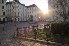 Sunny Mozart Platz (artem.a) Tags: wideangle lensflare magichour olympusom zuiko21mmf35 sonya7