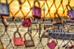 It's a love thing  (pascaledekker) Tags: bridge sunset sky holland love yellow skyline rotterdam colorful outdoor locks hdr euromast lovelocks rijnhavenbrug