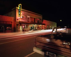 Streaking Through Isleton (RZ68) Tags: isleton california old vintage neon sign colors night long exposyre delta river sacramento central valley bar casino velvia provia e100 wide angle cars traffic light trails streks chevy chevrolet pickup truck brown street bay area
