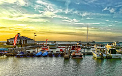 Lake Erie sunset  Sandusky, Ohio (SteveMather) Tags: sunset ohio lake docks boats restaurant golden harbor dock ship pad cargo greatlakes hour sail erie jetski freighter topaz sandusky docksidecafe procamera vividhdr