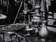 Antique Shop (`ARroWCoLT) Tags: antiqueshop arrowcolt samsung nx old goods metal sidewalk istanbul photography face outdoor monochrome blackwhite siyahbeyaz table nx300 30mm bright day sharp f2 blackandwhite street skdar antique antika eskici samovar semaver ibrik marapa coins coin bokeh dof depthoffield