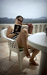 Spain 2016 - Nokia Lumia 1020 - Lisa reading on the balcony (TempusVolat) Tags: gareth wonfor tempusvolat garethwonfor tempus volat mrmorodo holiday spainholiday spain 2016 spain2016 vacance summer wife brunette reading girl woman shorts shortpants short book read reader