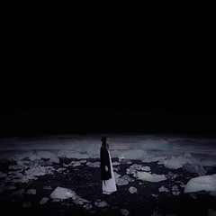 Searching (Beata Rydn) Tags: life ice nature water fairytale night canon dark square landscape outside iceland darkness emotion sleep dream dramatic naturallight dreaming nightshoot unknown imagination dreamy conceptual universe nightgown blackbeach imaginative fineartphotography jkulsrln neverending existance landscapephotography moonlandscape hypnagogic fallingasleep iceblocks conceptualphotography hypnagogia swedishphotographer rydn darkfairytale fotokonst canon5dmarkii betweenawakeandasleep iceonbeach swedishphotography thesleepproject beataryden beatarydn konceptuelltfotografi konceptuellt fotokonstnr svensktfotografi womanstandingonbeach