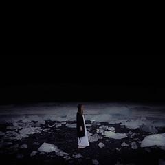 Searching (Beata Rydn) Tags: life ice nature water fairytale night canon dark square landscape outside iceland darkness emotion sleep dream dramatic naturallight dreaming nightshoot unknown imagination dreamy conceptual universe nightgown blackbeach imaginative fineartphotography jkulsrln neverending existance landscapephotography moonlandscape hypnagogic fallingasleep iceblocks conceptualphotography hypnagogia swedishphotographer rydn darkfairytale fotokonst canon5dmarkii betweenawakeandasleep iceonbeach swedishphotography thesleepproject beataryden beatarydn konceptuelltfotografi konceptuellt fotokonstnr svensktfotografi womanstandingonbeach