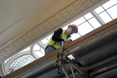 Assessing the stained glass window above the spiral stairs. (Minnesota State Capitol Restoration Project) Tags: people art minnesota architecture construction state interior stainedglass capitol restoration renovation mn skylights preservation historicpreservation 1905 2014 historicbuilding
